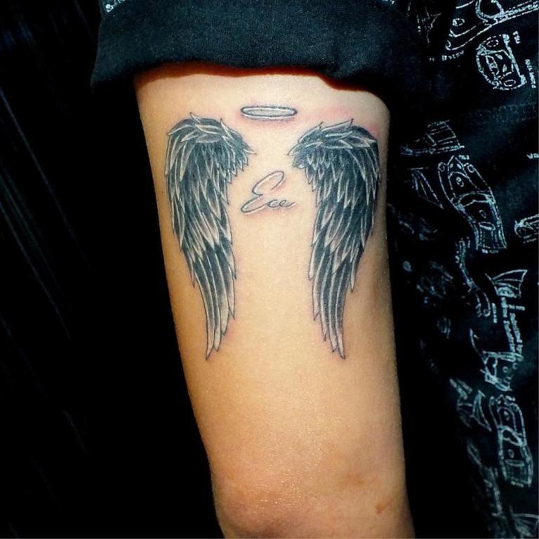 Тату крылья с нимбом