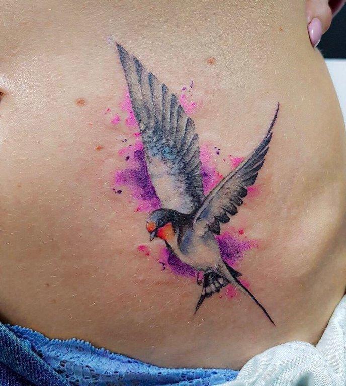 Татуировка на животе женская