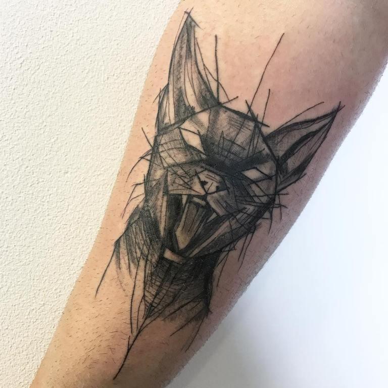 татуировки для мужчин на ноге