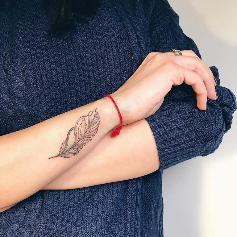татуировка перо значение