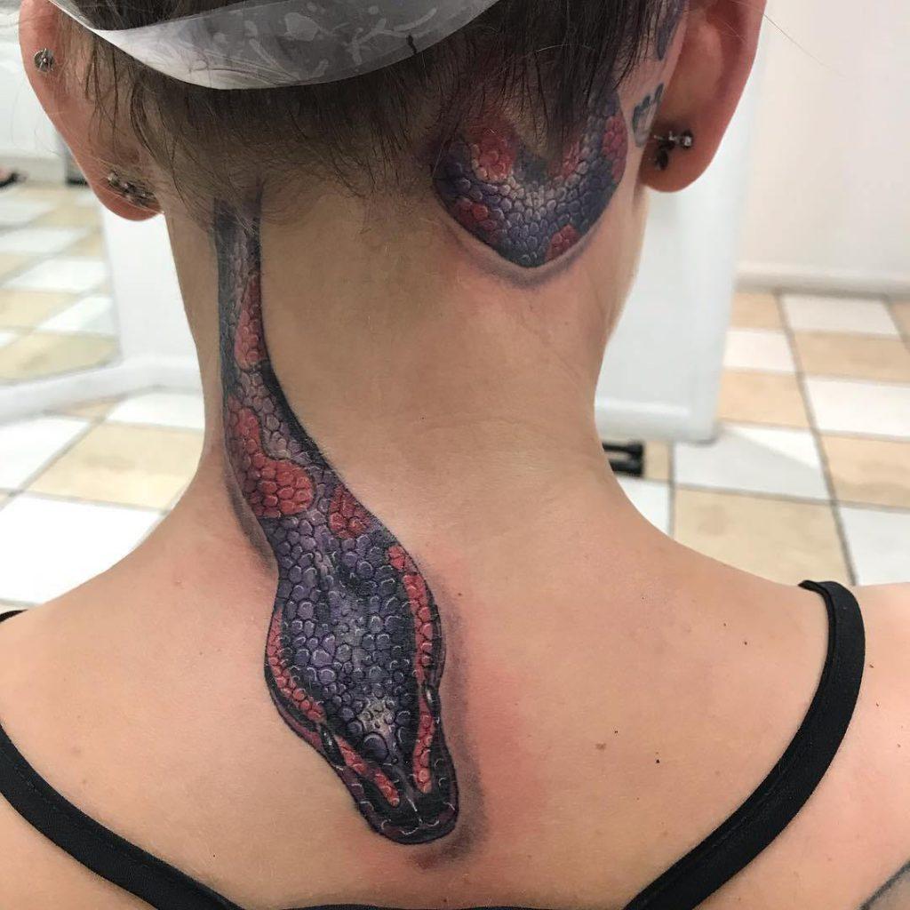 значение татуировки змеи