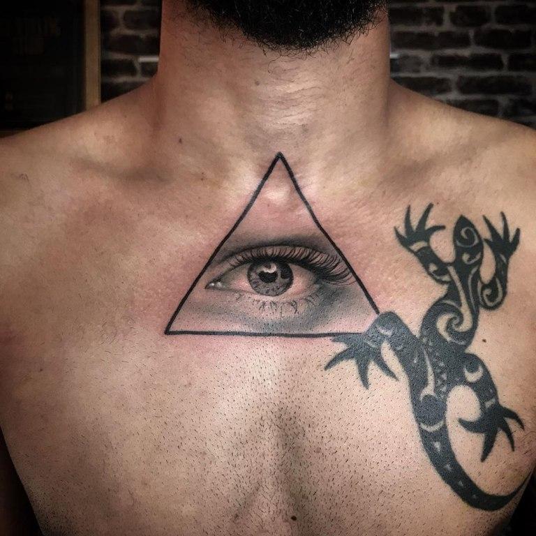 глаз в треугольнике значение тату