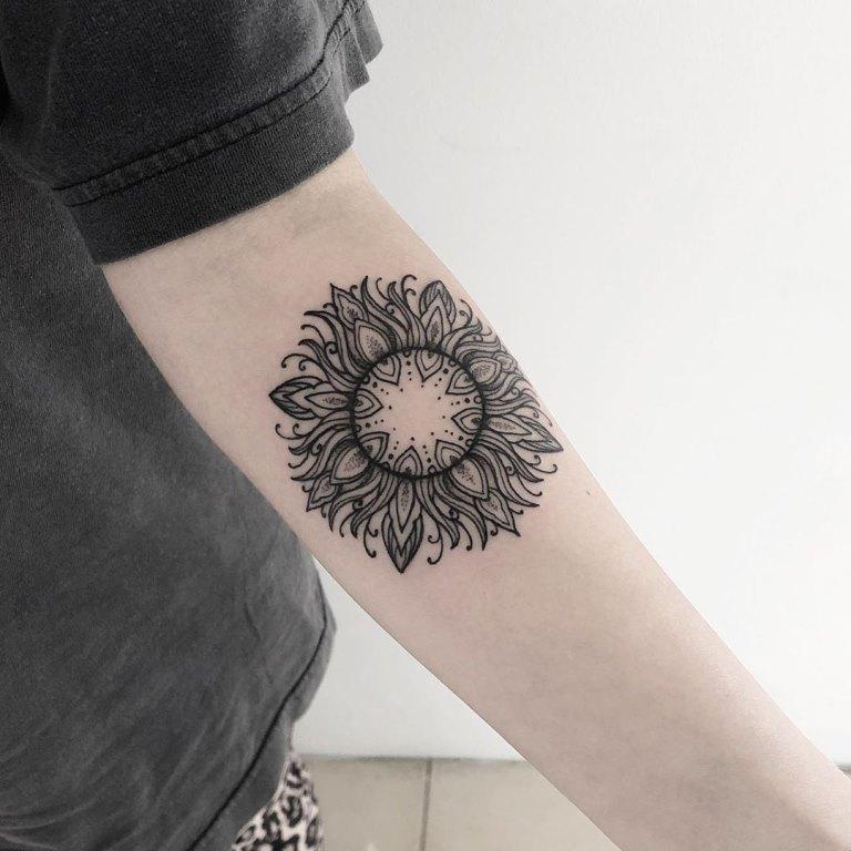татуировка солнце значение