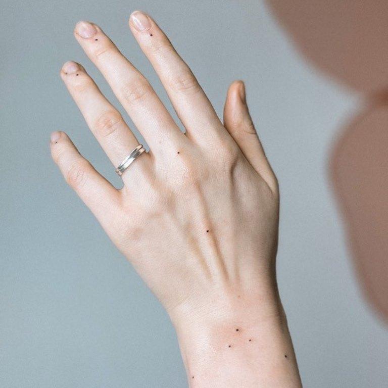 наколка точка на руке что значит