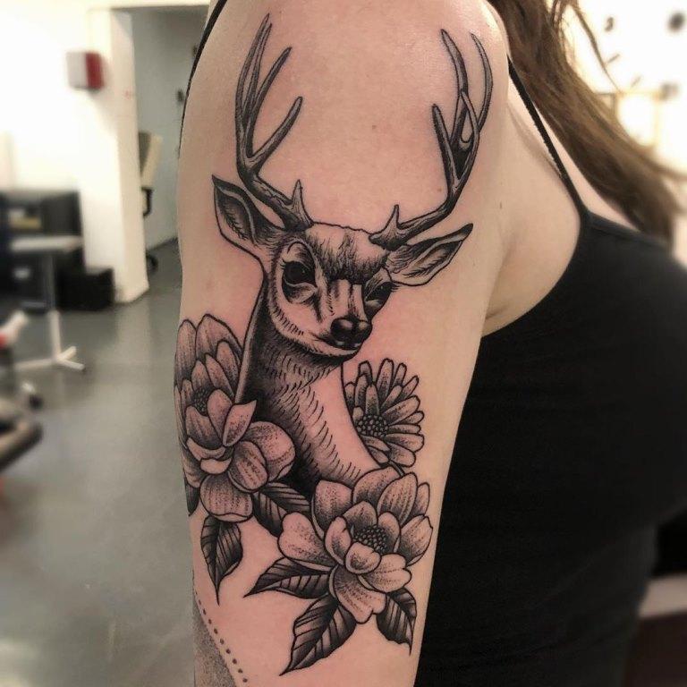 что означает татуировка олень
