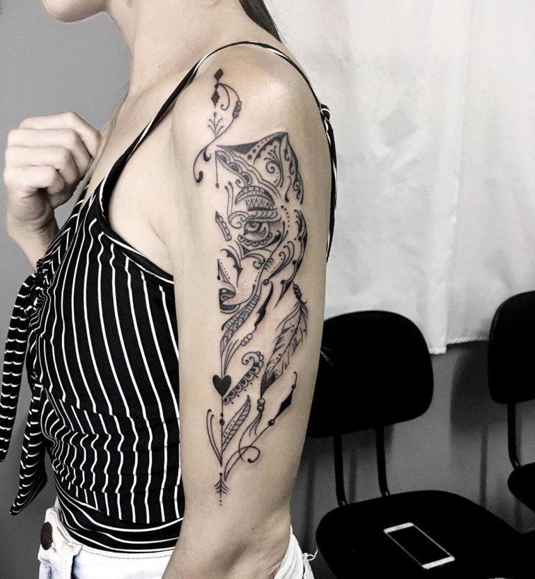 татуировка волчица