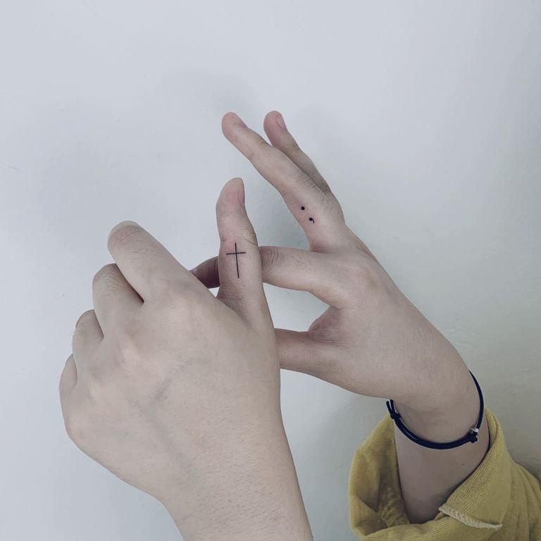 что значит крест на пальце